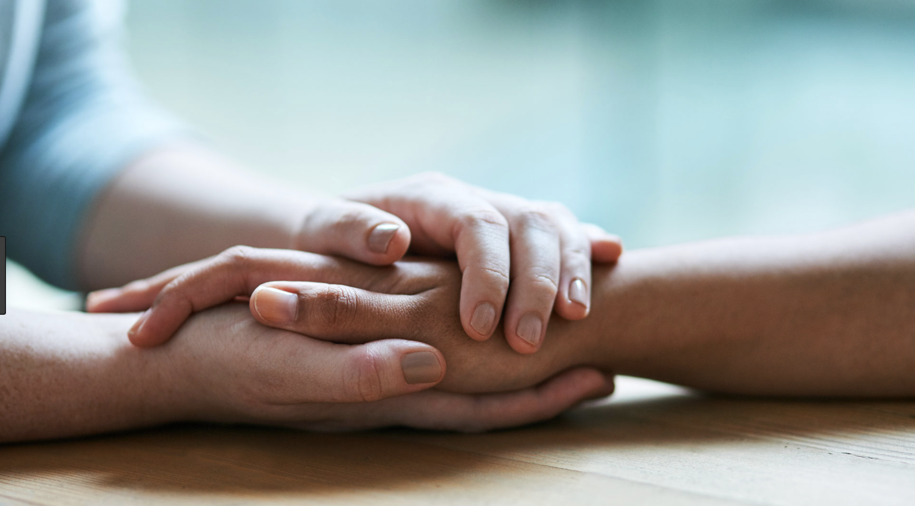 Caring person holding hands