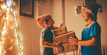 Child giving gift to another child